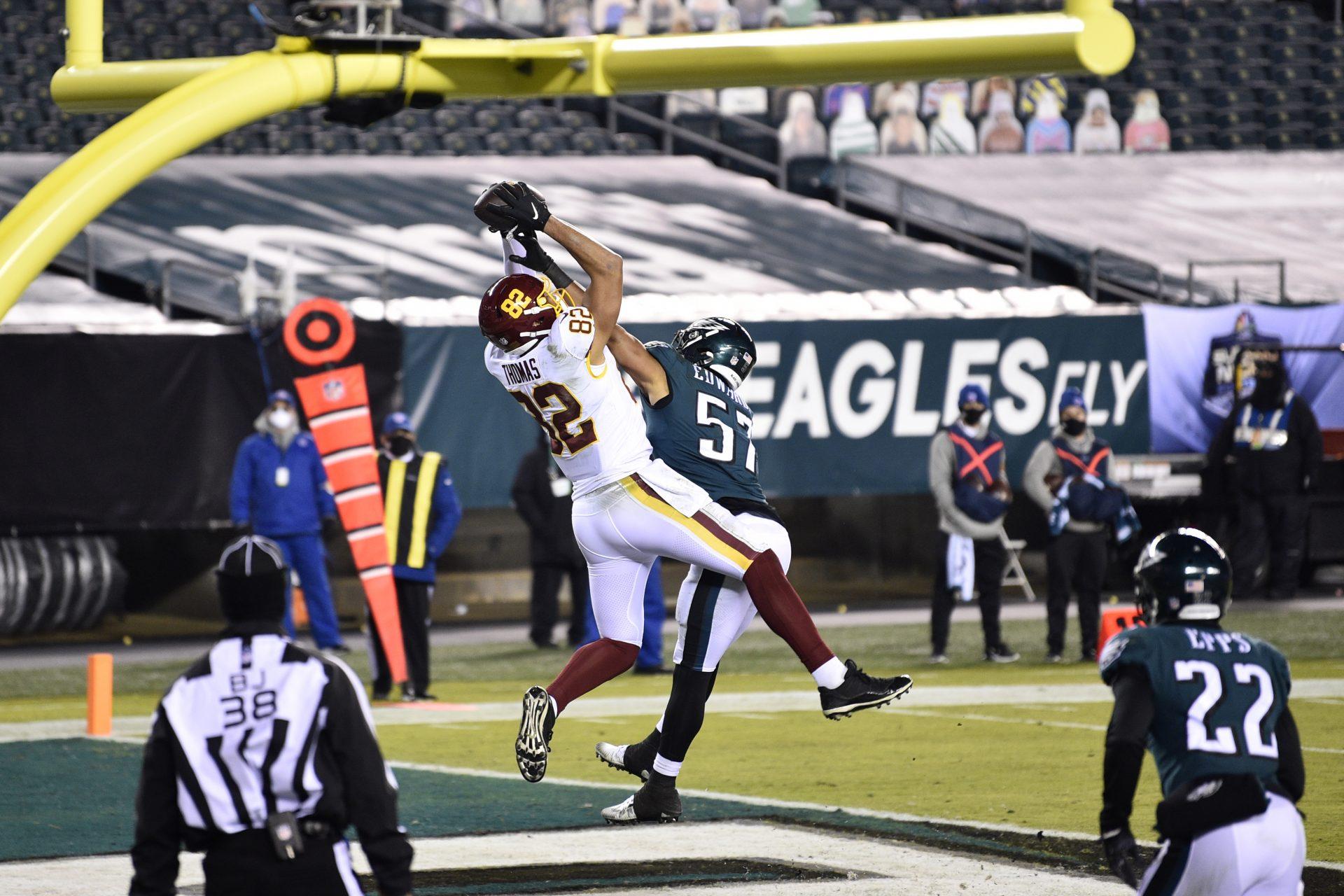 Washington Football Team's Logan Thomas (82) catches a touchdown against Philadelphia Eagles' T.J. Edwards (57) during the first half of an NFL football game, Sunday, Jan. 3, 2021, in Philadelphia.