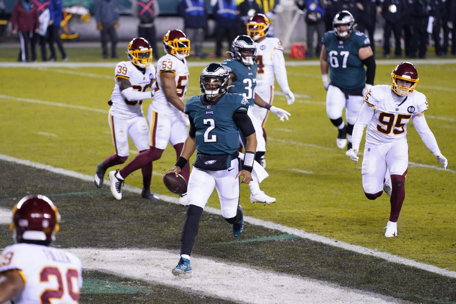 Philadelphia Eagles' Jalen Hurts (2) scores a touchdown during the first half of an NFL football game against the Washington Football Team, Sunday, Jan. 3, 2021, in Philadelphia.