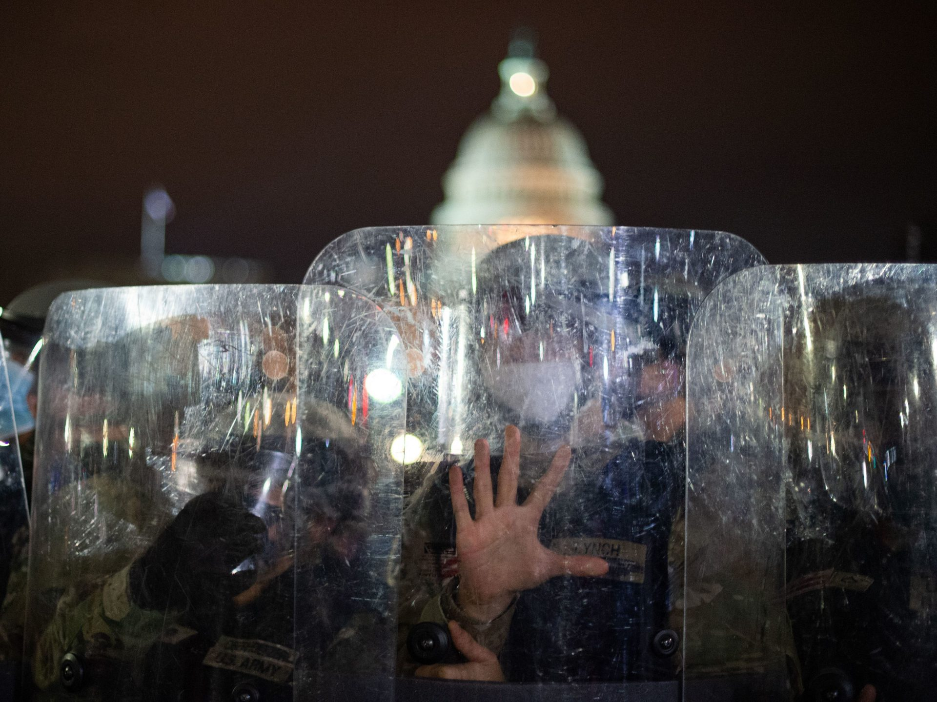 National Guard troops are seen behind shields as they clear a street from protestors outside the Capitol building on January 6, 2021 in Washington, DC.