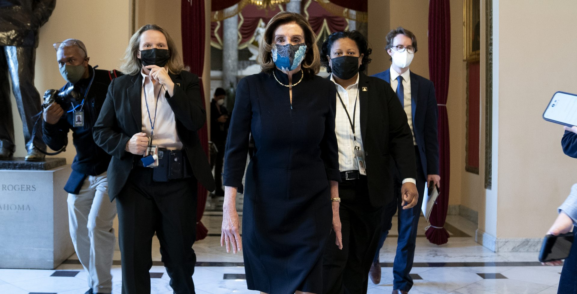 """House Speaker Nancy Pelosi, D-Calif., said that impeaching President Trump is """"a constitutional remedy that will ensure that the republic will be safe from this man."""" She's seen here walking to the House floor on Wednesday, ahead of the vote."""