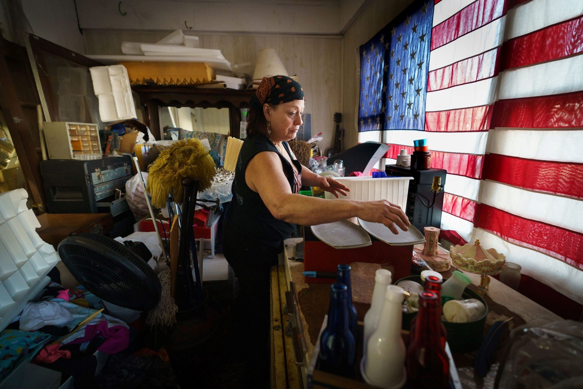 Sandra Huffman, shown here at her home in East Greenville, Pa., has been unemployed since April when she got sick while working a hospital cleaning job. She has been receiving money from the coronavirus assistance fund, but has struggled during a monthlong gap in benefits.