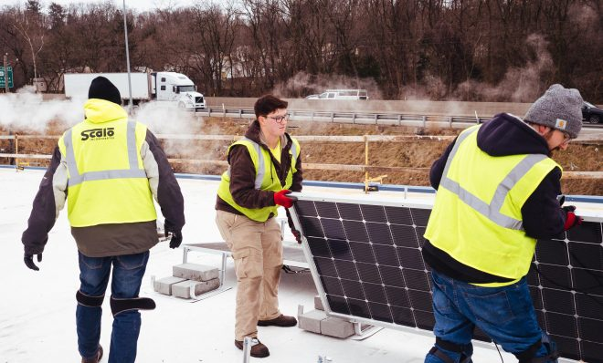 Workers install solar panels on the roof of Global Links, a medical relief nonprofit, in Green Tree, Pa., on Wednesday, Feb. 5, 2020.