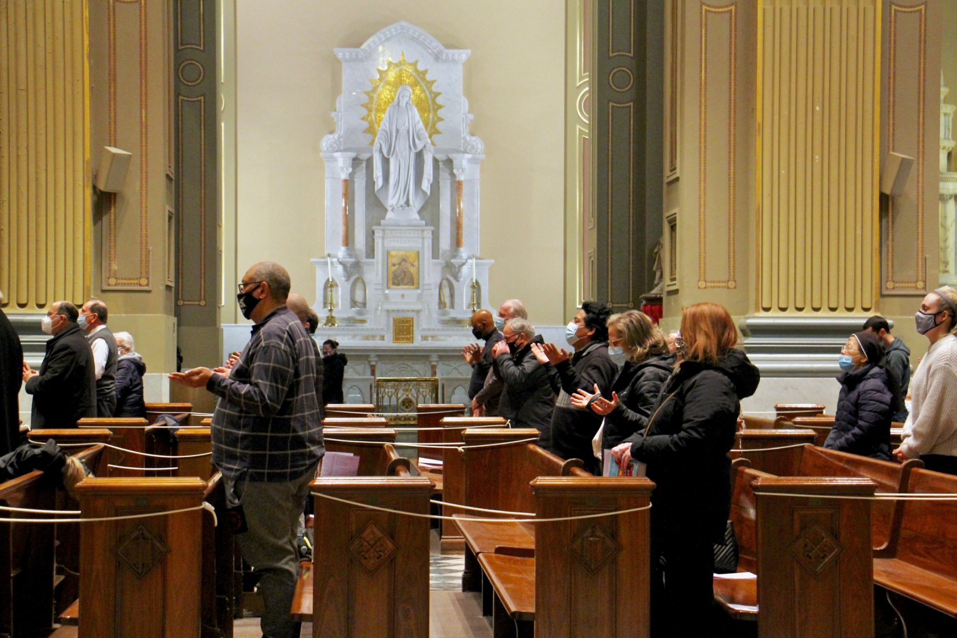 Seated in every other pew to create safe distances, parishioners pray during Ash Wednesday services at the Basilica of Saints Peter and Paul in Philadelphia