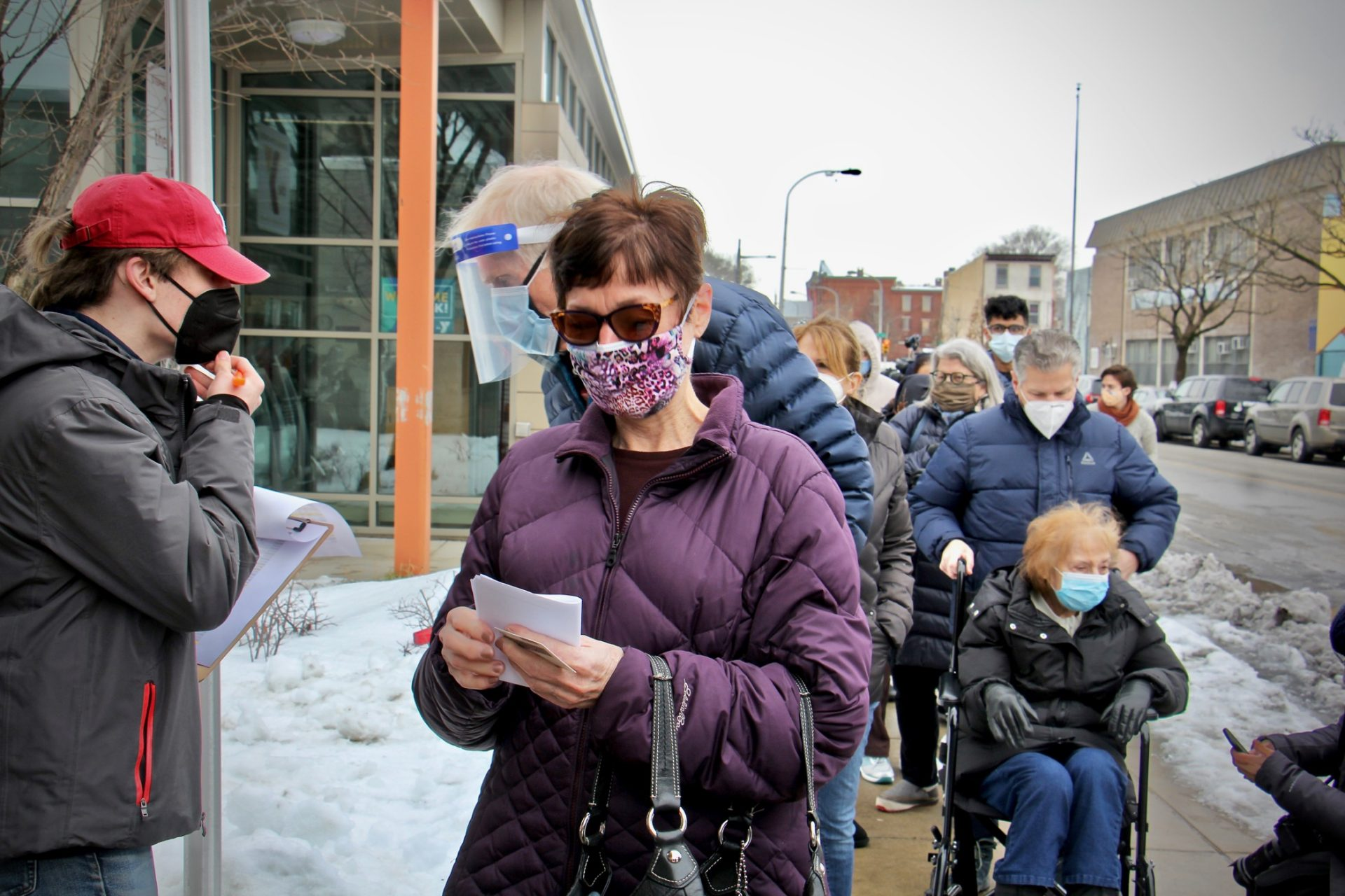Judy Salisbury, 70, of Rittenhouse Square (center) signed up on line to get her COVID-19 vaccination at Philadelphia's first standing city-run COVID-19 vaccination clinic, which opened at the Martin Luther King Jr. Older Adult Center on Cecil B. Moore Avenue, Tuesday, Feb. 23, 2021.