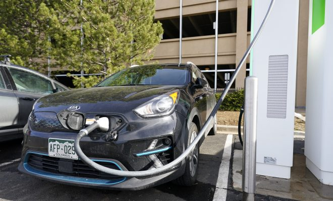 A Kia Niro EV is charged at a charging station at Colorado Mills Outlet Mall Monday, Dec. 21, 2020, in Lakewood, Colo.