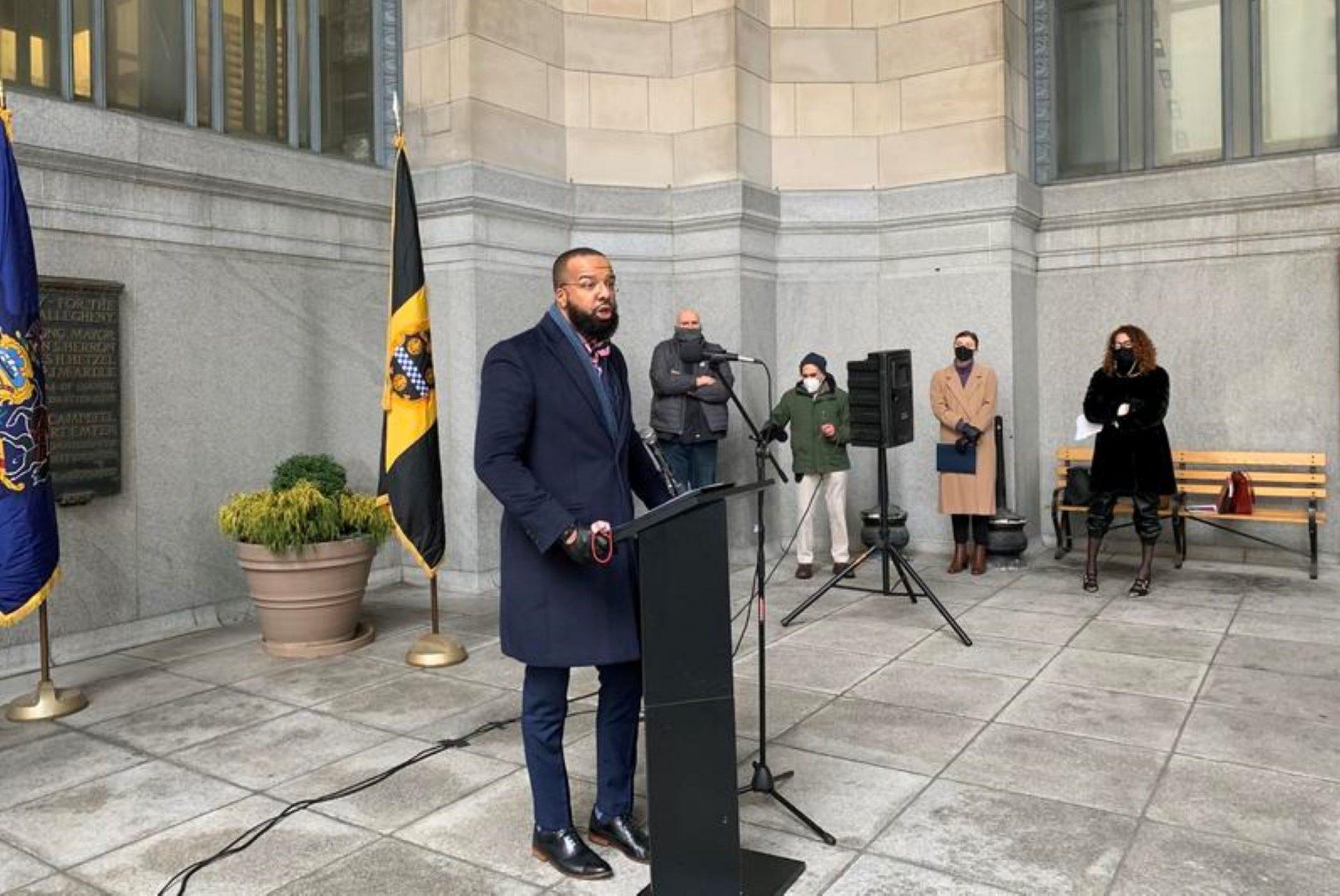 The Secretary of Pennsylvania's Board of Pardons, Brandon Flood, speaks outside Pittsburgh's City-County Building Friday, Feb. 12, 2021.