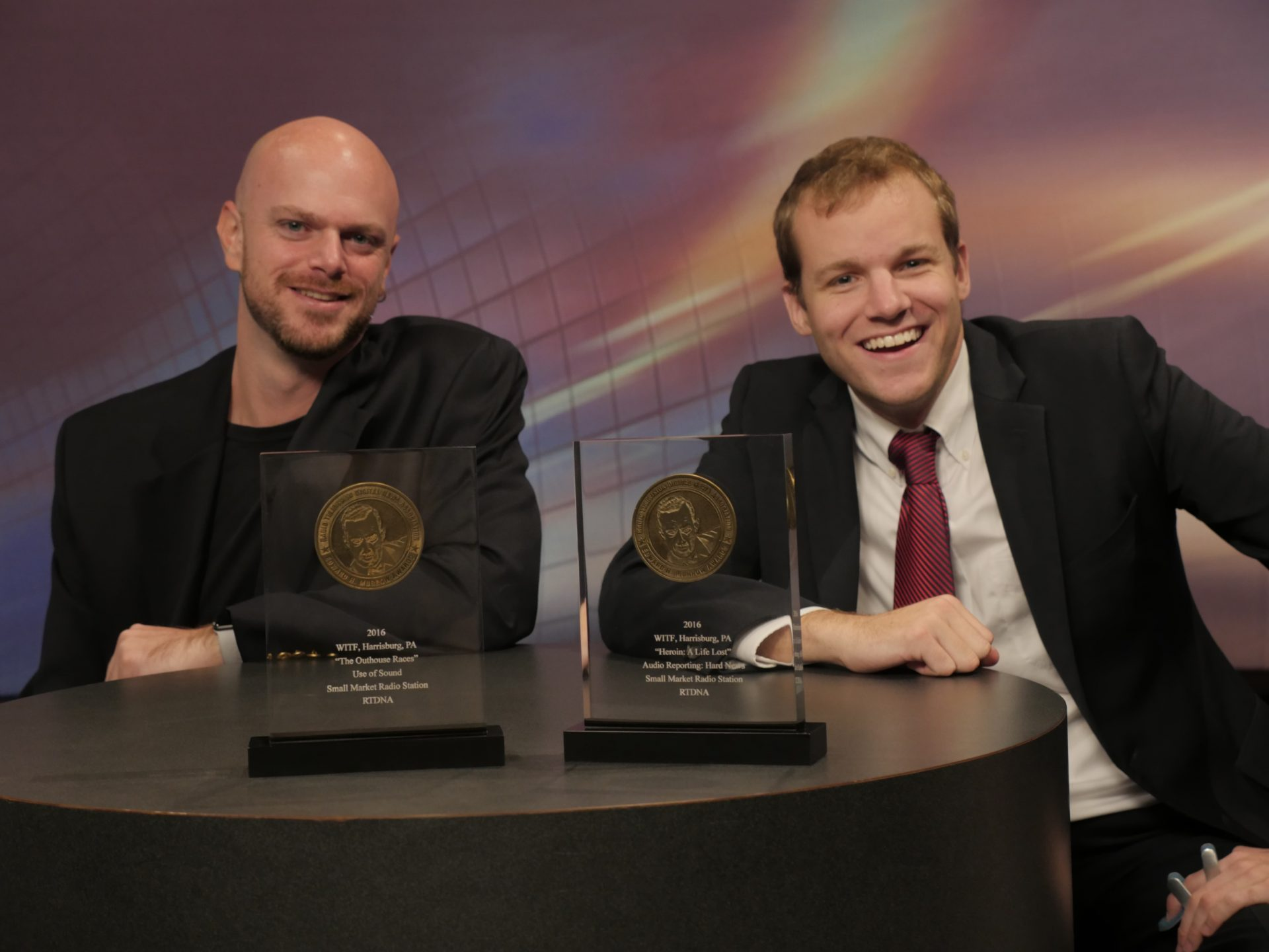Joe Ulrich and Ben Allen pose with National Edward R. Murrow Award plaques recognizing their work in October 2016.