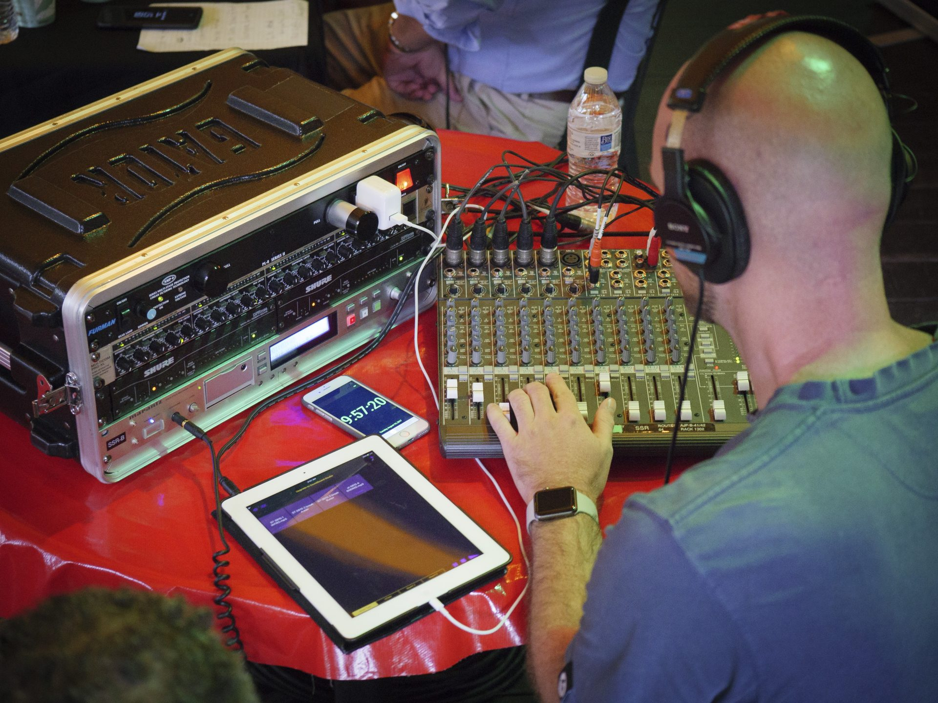 Joe Ulrich monitors the audio during a remote Smart Talk broadcast from the Jigger Shop in Mount Gretna on Aug. 15, 2017.