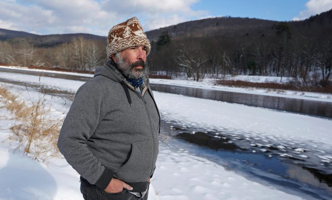 Steve Schwartz stands on his property right along the Delaware River in Equinunk, Pennsylvania.