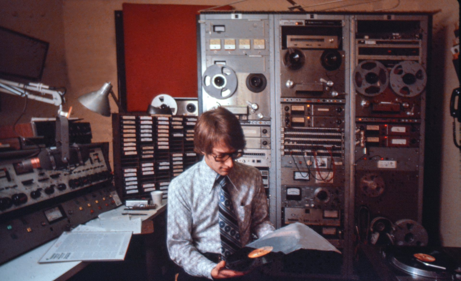 David Ginder, WITF Music Director from 1978 – 1985, selects the next classical tune to air on WITF FM, from the Hershey Community Building circa 1979.