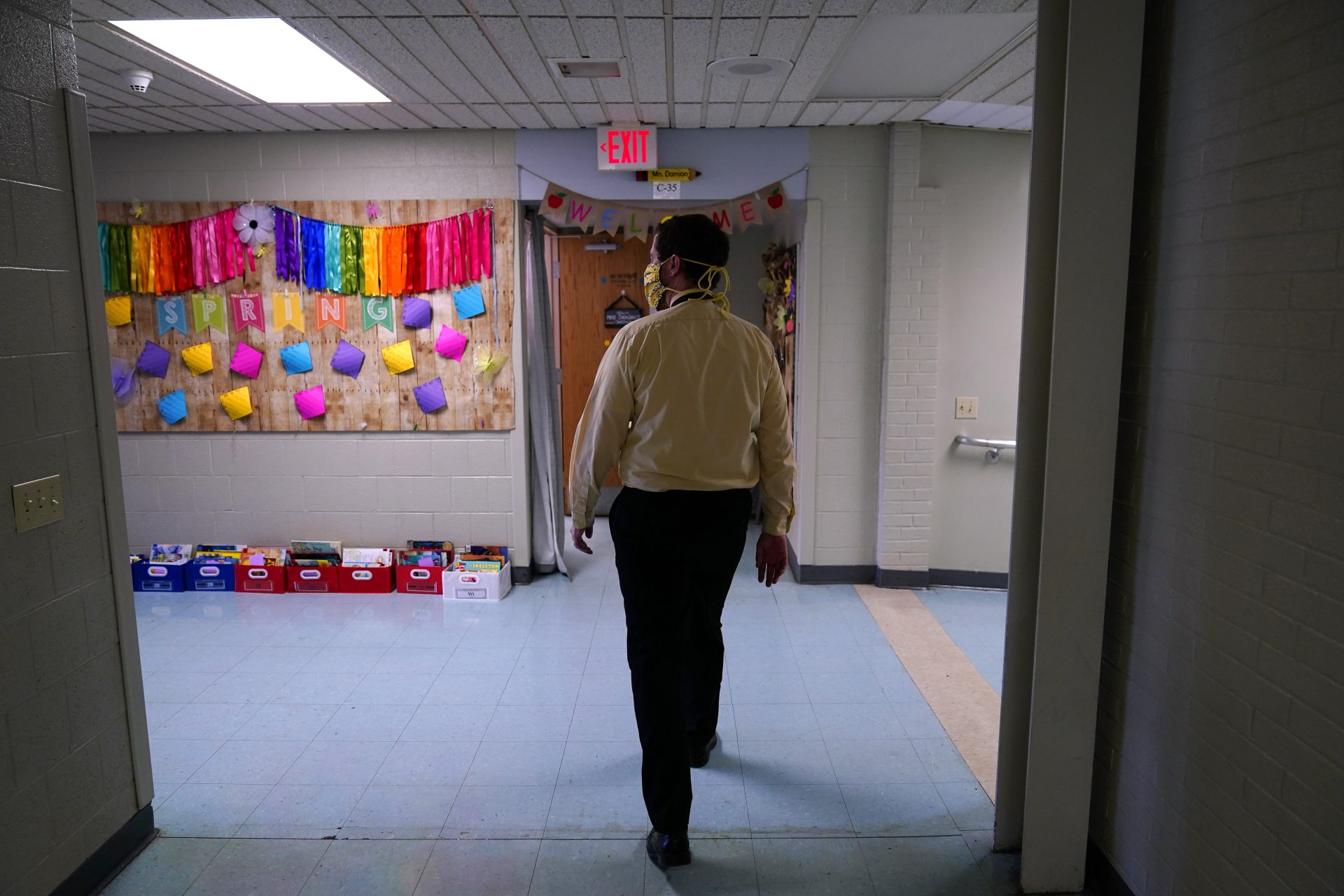 Principal Rob Palazzo walks down a hall at Panther Valley Elementary School, Thursday, March 11, 2021, in Nesquehoning, Pa. On May 26, 2020, former student, 9-year-old Ava Lerario; her mother, Ashley Belson, and Ava's father, Marc Lerario, were found fatally shot inside their home. Palazzo says he and the rest of the school and community are grappling with the what-ifs: What if school had been open, and they had a chance to save Ava?