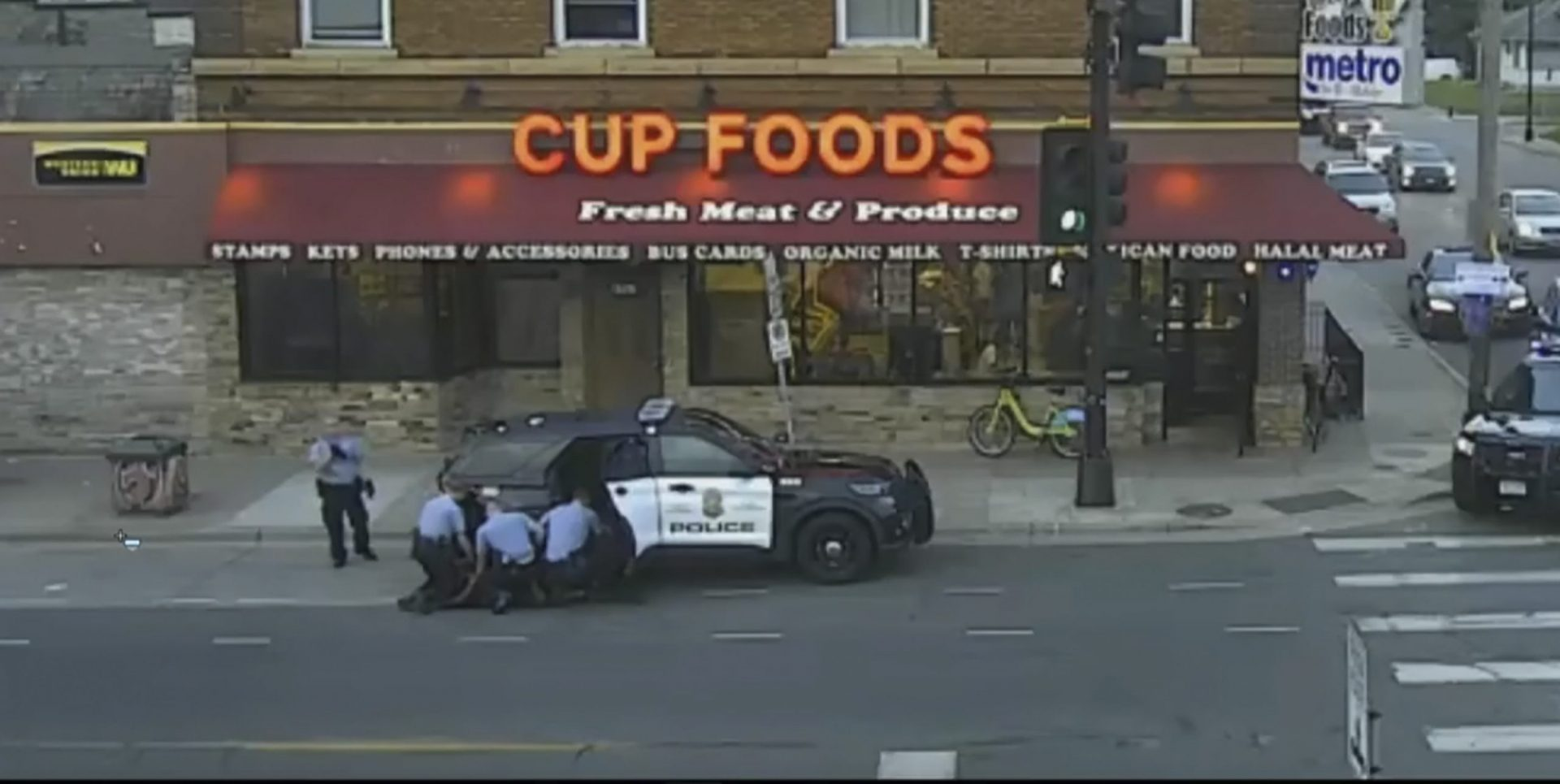 In this image from Minneapolis city surveillance video, Minneapolis police are seen attempting to take George Floyd into custody May 25, 2020, in Minneapolis, Minn. The video was shown as Hennepin County Judge Peter Cahill presides Monday, March 29, 2021, in the trial of former Minneapolis police officer Derek Chauvin, in the death of George Floyd at the Hennepin County Courthouse in Minneapolis, Minn. (