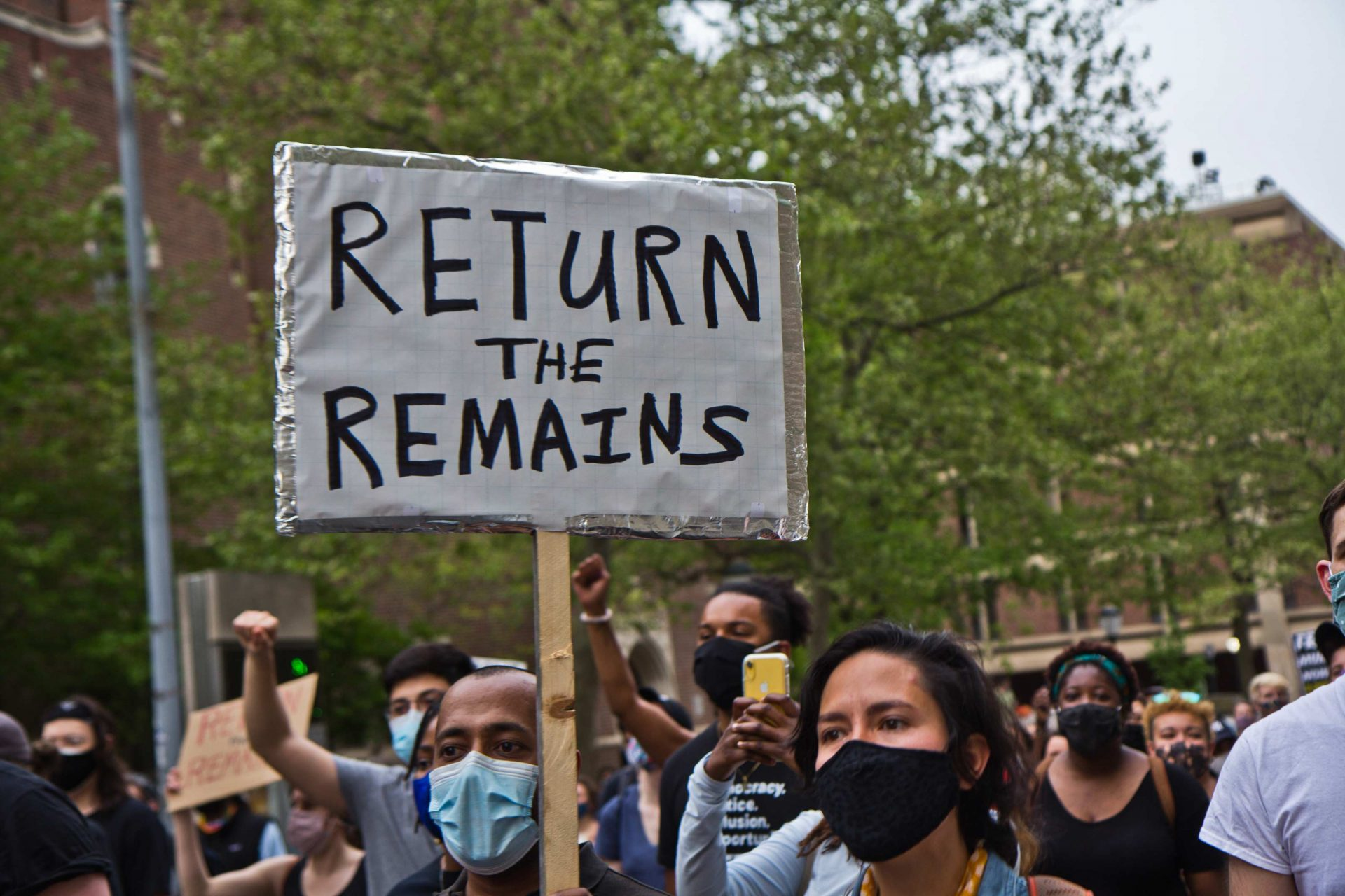 Protesters marched on the University of Pennsylvania's Campus on April 28, 2021, over the Penn Museum's mistreatment of the remains of children Tree and Delisha Africa who were killed when Philadelphia police bombed the MOVE Organization's headquarters in 1985.
