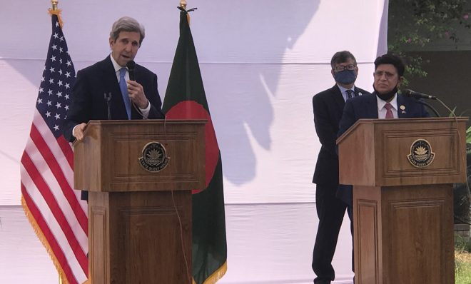 John Kerry, the special U.S. envoy on climate, speaks with Bangladeshi Foreign Minister A.K. Abdul Momen standing beside him in Dhaka, Bangladesh, Friday, April 9, 2021. Kerry said Friday that President Joe Biden was keen to work with Bangladesh in dealing with climate change impacts after the United States' return to the Paris accord.