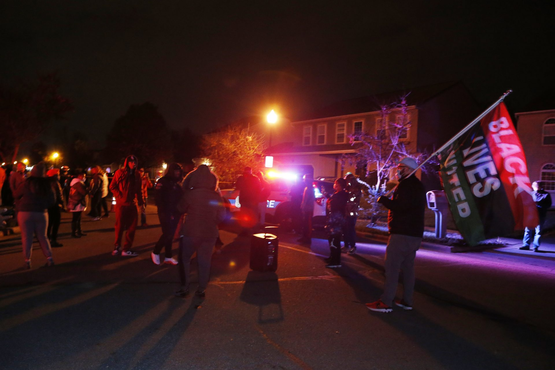 A crowd gathers to protest in the neighborhood where a Columbus police officer fatally shot a teenage girl, Tuesday, April 20, 2021, in Columbus, Ohio.