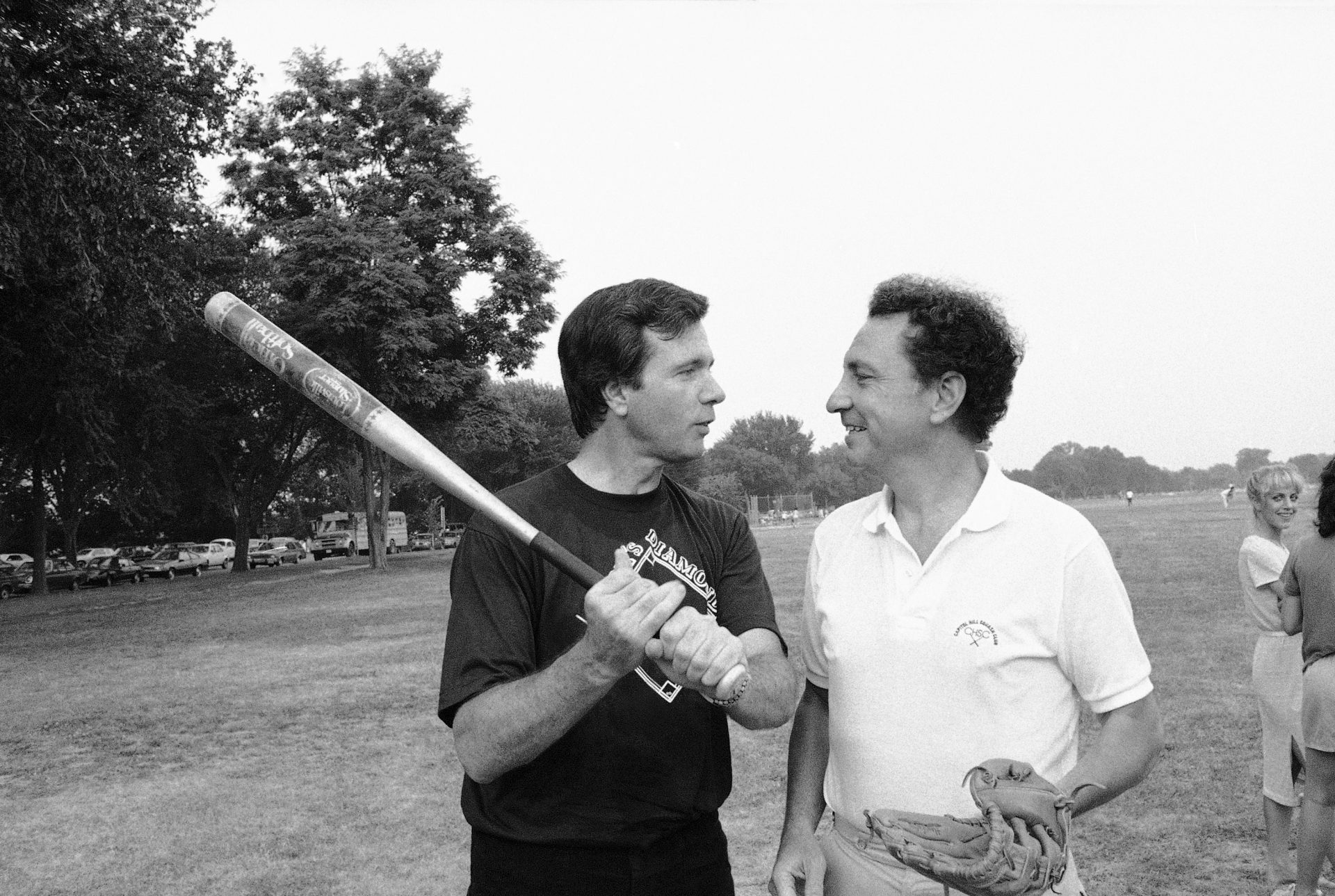 Sens. John Heinz, left, and Arlen Specter, grapple for first batting privileges, just before their two offices started a softball competition in Washington Tuesday, July 20, 1983. The two Pennsylvania Republicans captained their respective teams.
