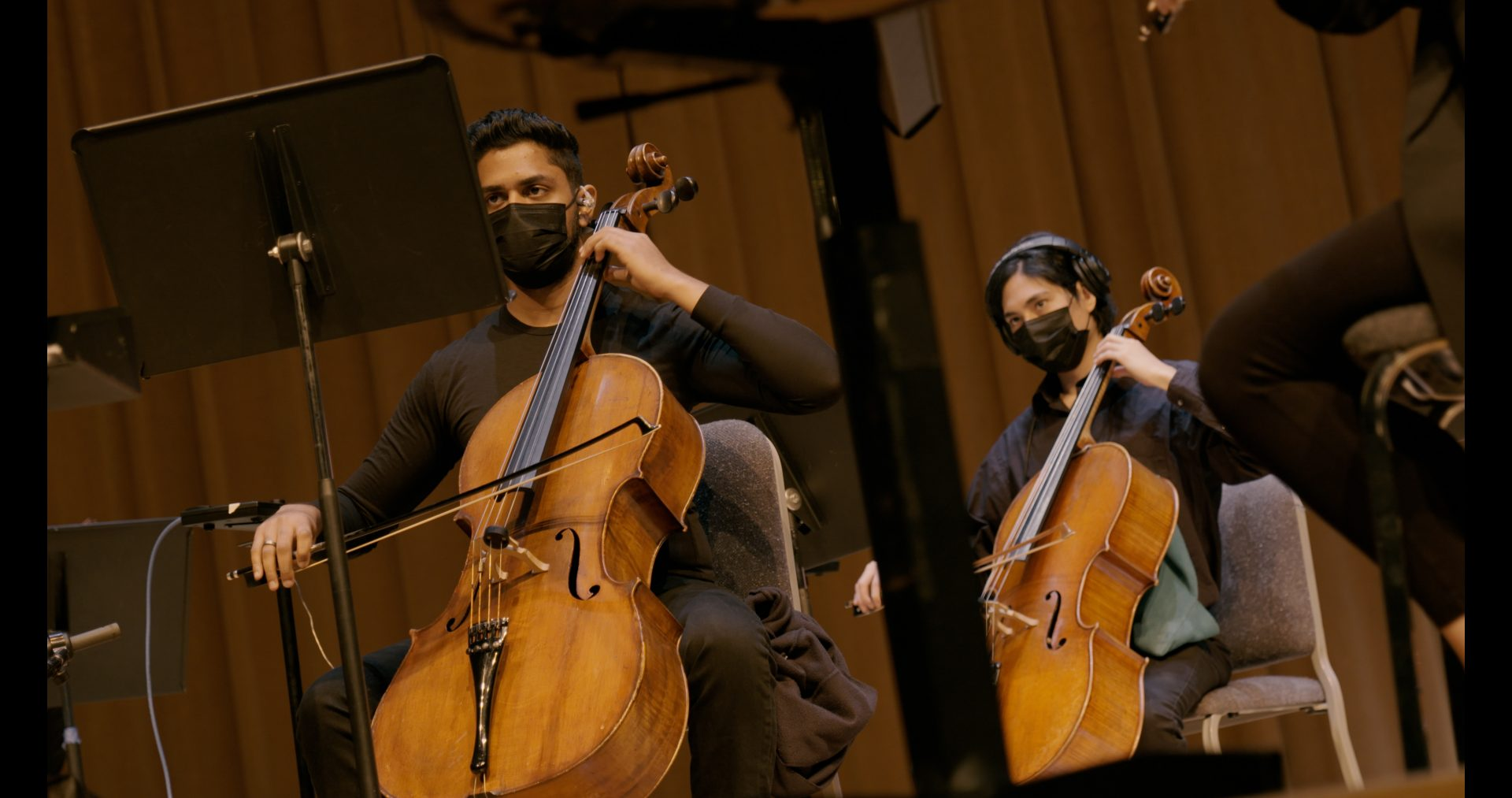 Cellists recording.