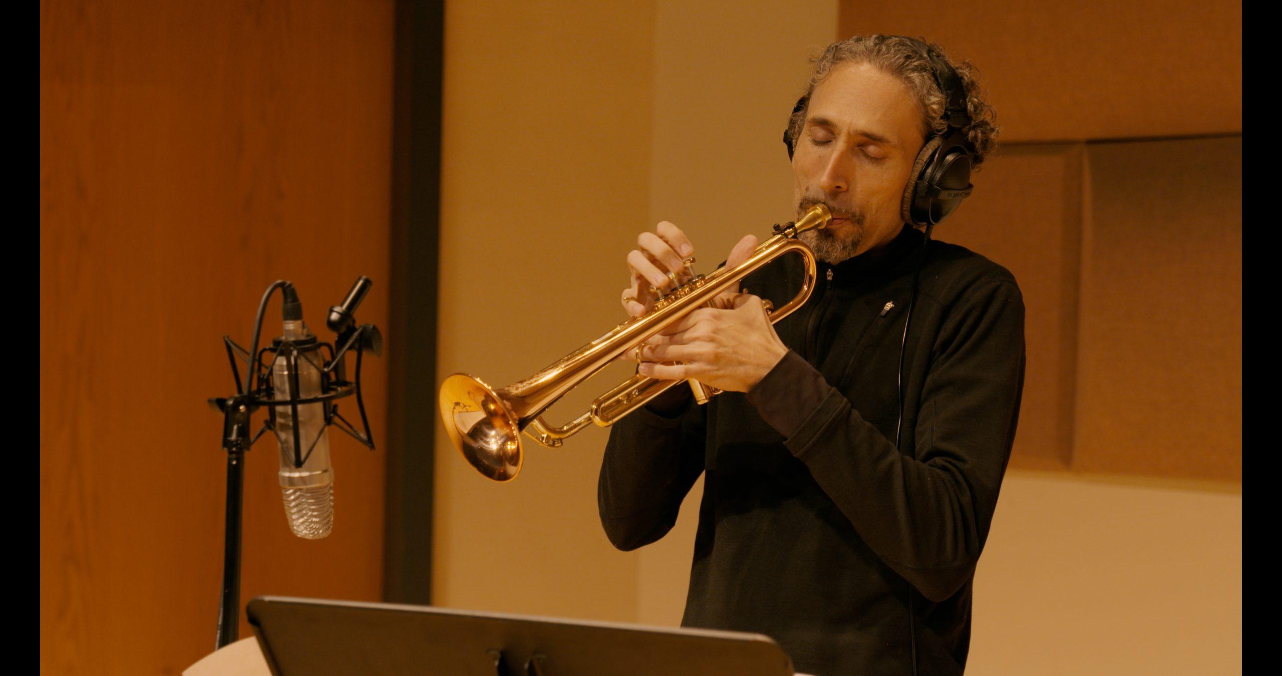 Trumpeter John Daversa performing during a recording session.