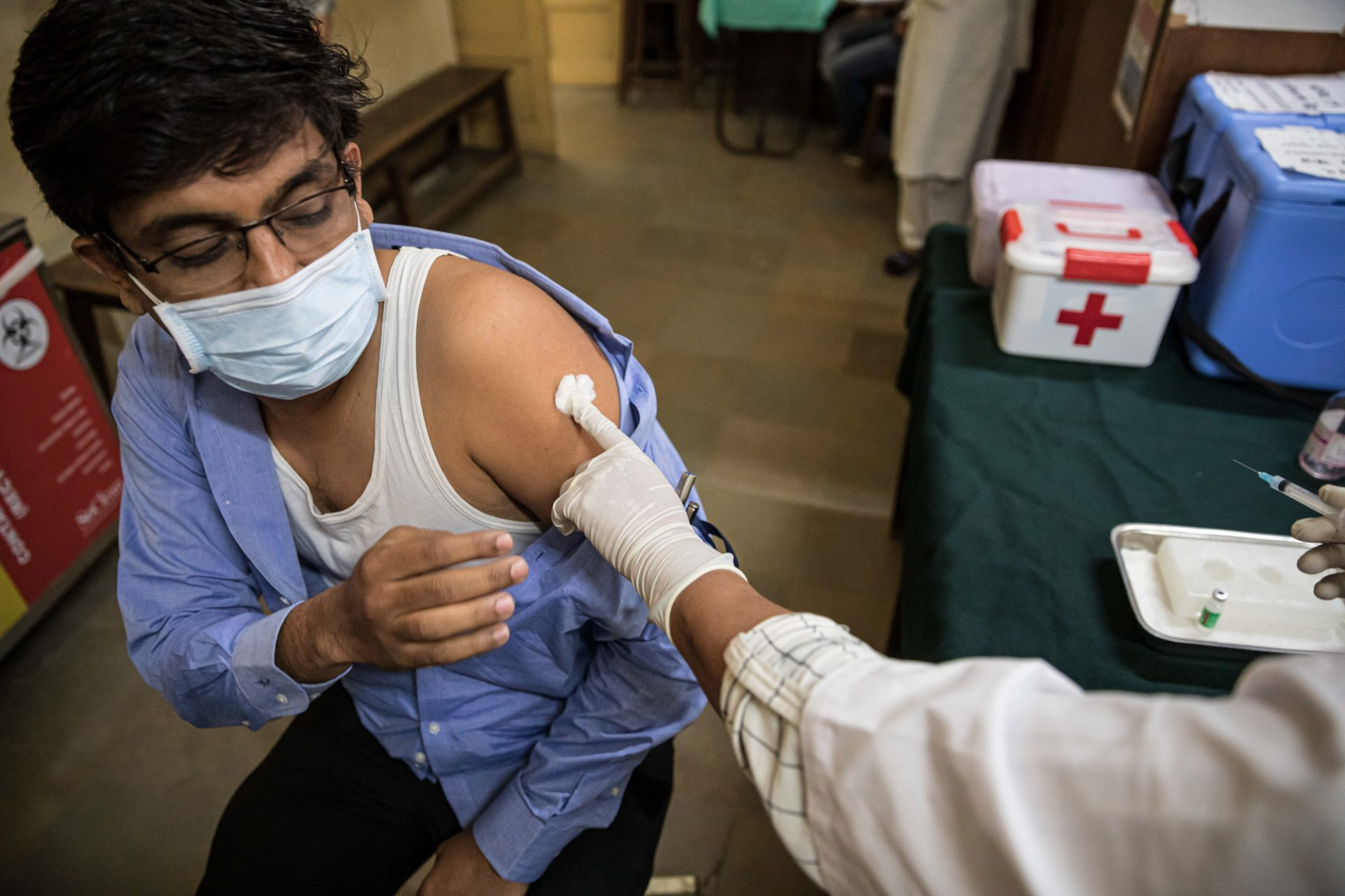 Amit Sonawane, 35, an engineer at a district health office, gets his first vaccine dose in Palghar, India.
