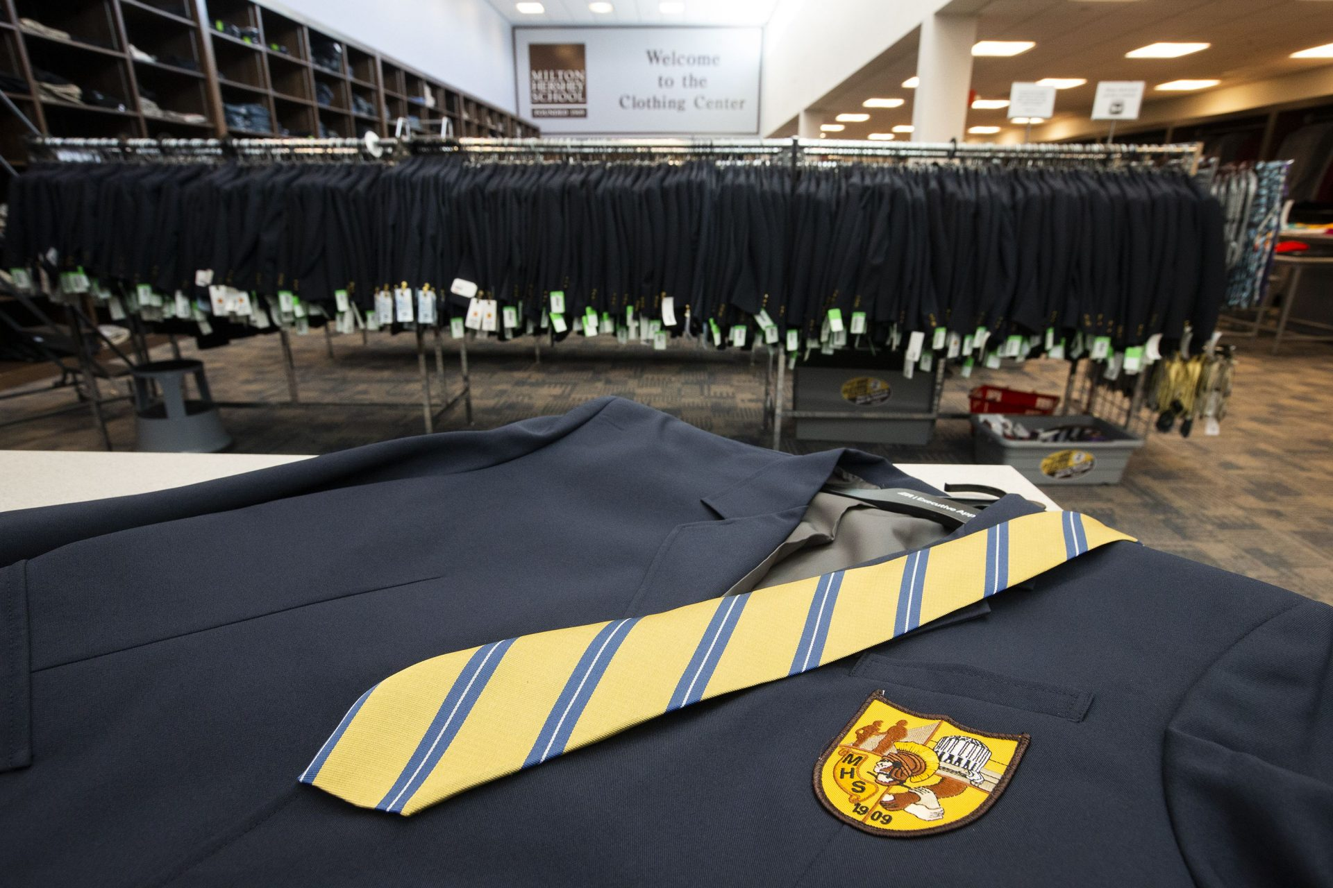 A tie and blazer at the school's supply center. Students must wear uniforms during the school day.
