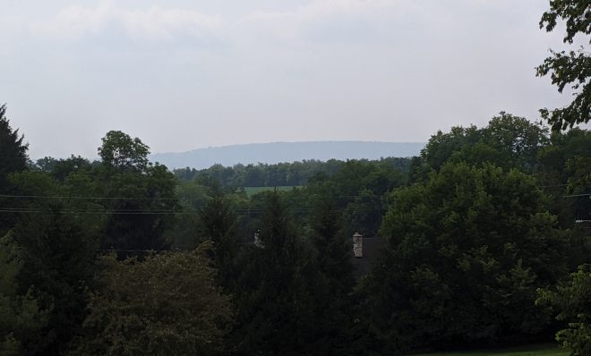 Haze from wildfires covers a mountain seen from Swatara Township, Dauphin County on Wednesday, July 21, 2021.