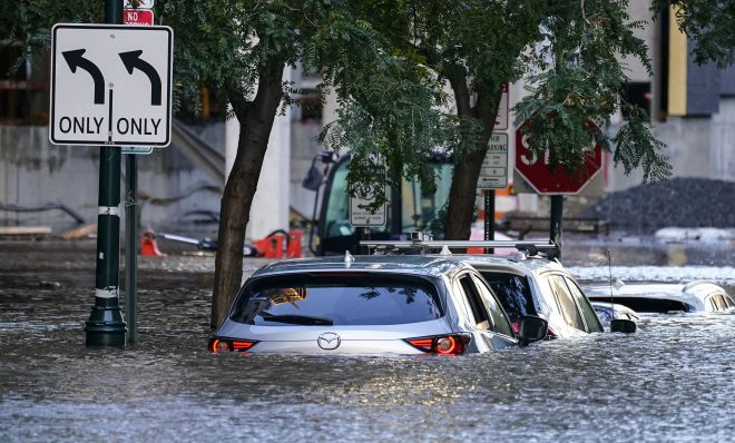 Vehicles are under water during flooding in Philadelphia, Thursday, Sept. 2, 2021 in the aftermath of downpours and high winds from the remnants of Hurricane Ida that hit the area.