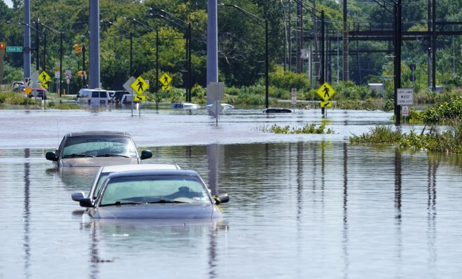 Vehicles are under water during flooding in Norristown, Pa. Thursday, Sept. 2, 2021 in the aftermath of downpours and high winds from the remnants of Hurricane Ida that hit the area. Scientists say climate change is contributing to the strength of storms like Ida.