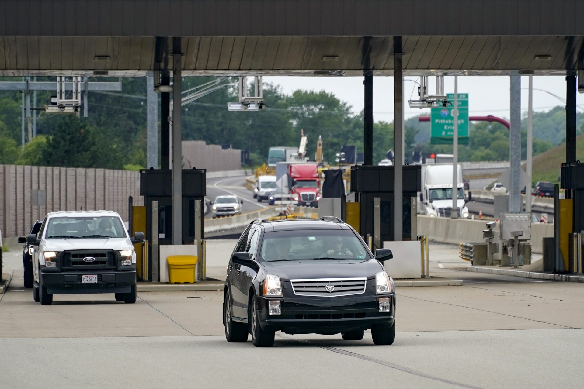 Traffic going eastbound on the Pennsylvania Turnpike proceeds through the electronic toll booths in Cranberry Township, Pa., on Monday, Aug. 30, 2021.