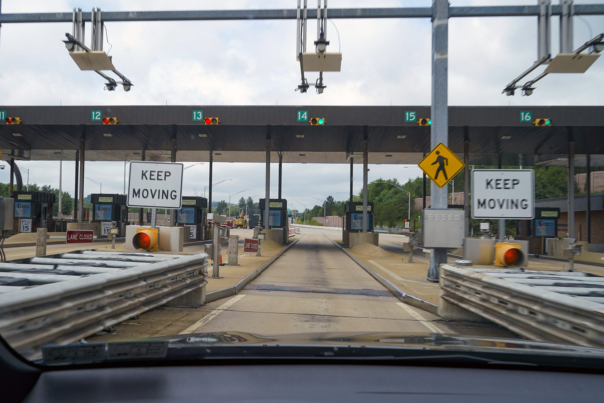 In this photo made through a windshield, the sensors and lights are seen at the west bound toll gate of the Pennsylvania Turnpike in Cranberry Township, Pa., on Monday, Aug. 30, 2021.