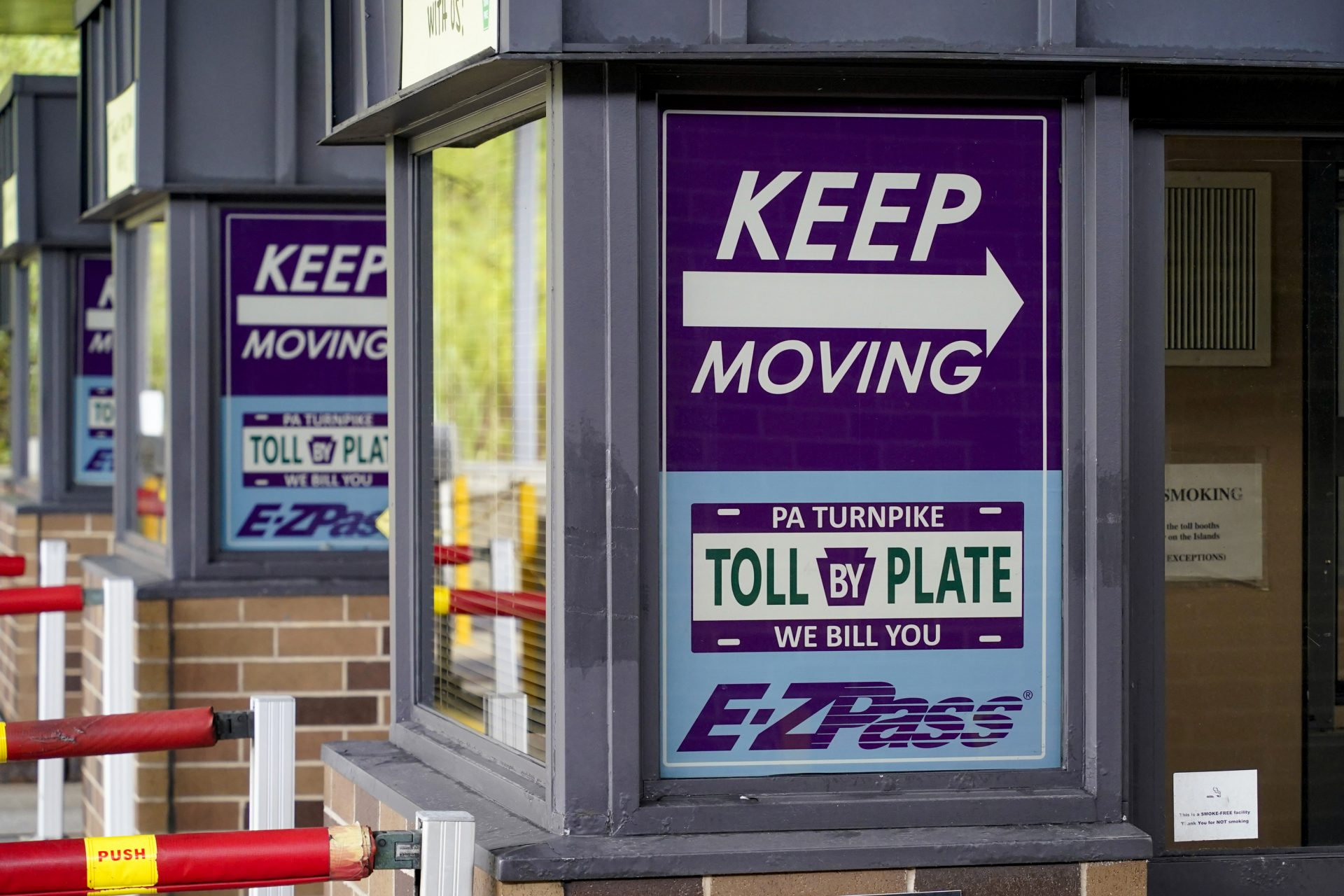 Signs on the electronic toll booths indicate to motorists entering the Pennsylvania Turnpike in Gibsonia, Pa. on Monday, Aug. 30, 2021, to keep moving and the methods being used to collect tolls.